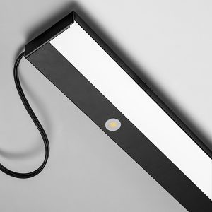 Nuance dim touch switch Linear L E D luminaire with black finish.