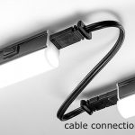 Example of a cable connection between two continuity linear light fixtures with a black finish.