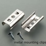 Metal mounting clips and screws for edge light fixture.