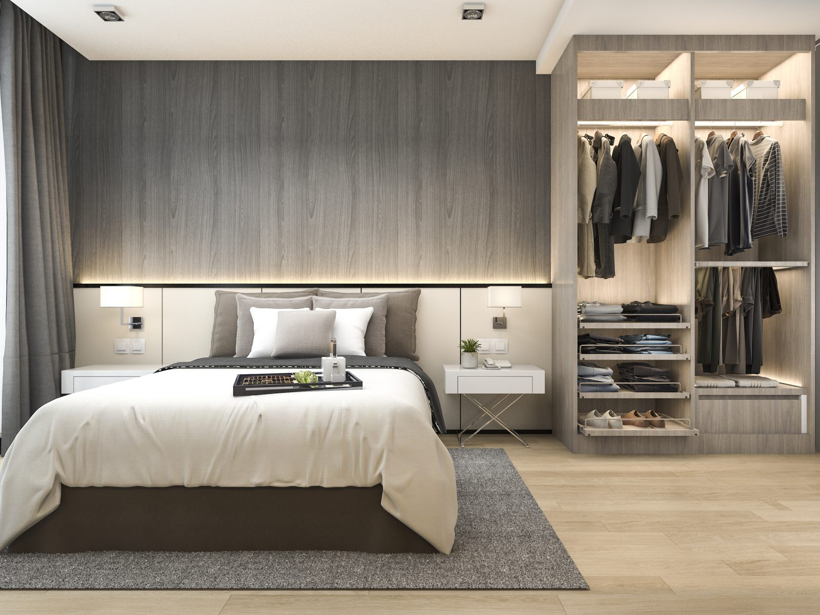 A hotel room with bed and illuminated closet containing clothes.